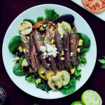 This seared steak salad with cilantro lime vinaigrette is so full of flavor you won't even remember you're eating a salad! #SauceOn #shop #cbias
