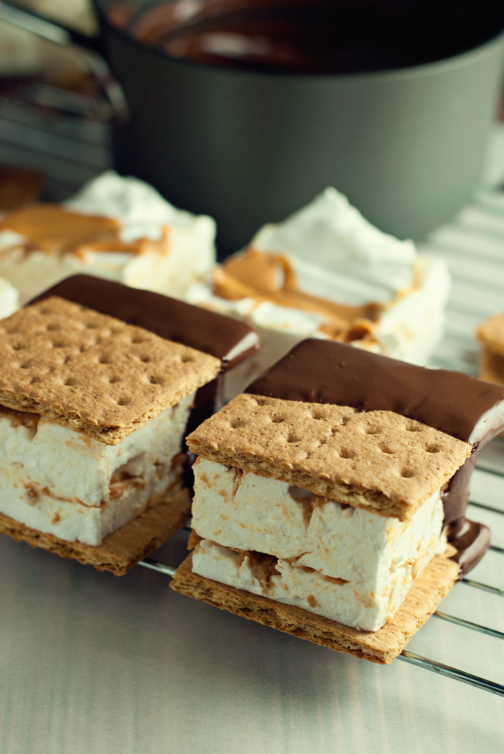 These chocolate peanut butter smores are sure to blow your mind with massive, fluffy, homemade marshmallows between crisp graham crackers, dripped in rich chocolate!
