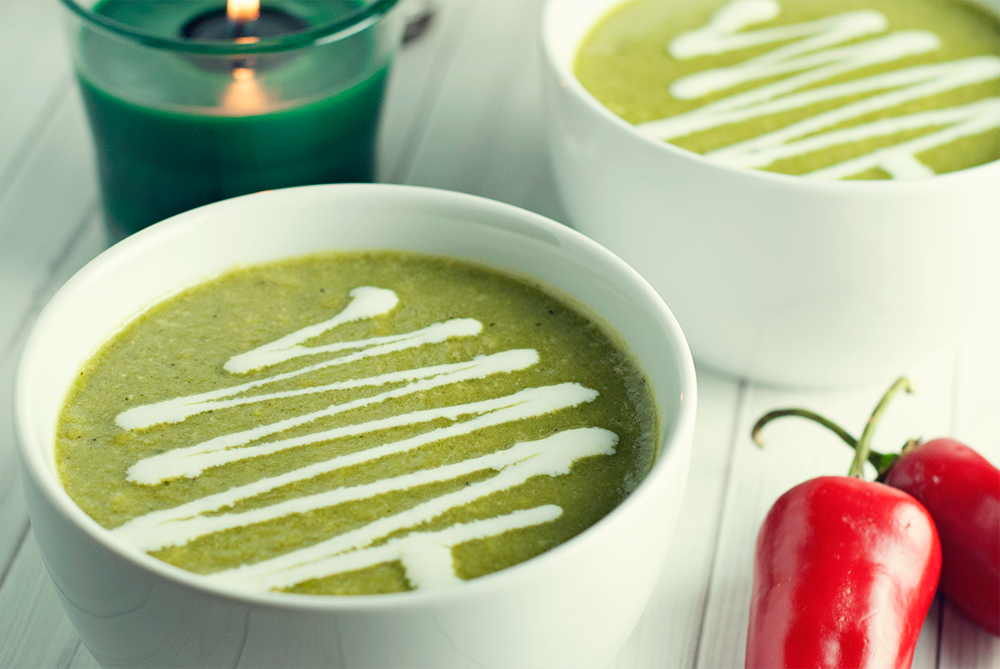 Warm your soul with this soothing, yet slightly spicy roasted poblano soup, garnished with a generous drizzle of crema for good measure!