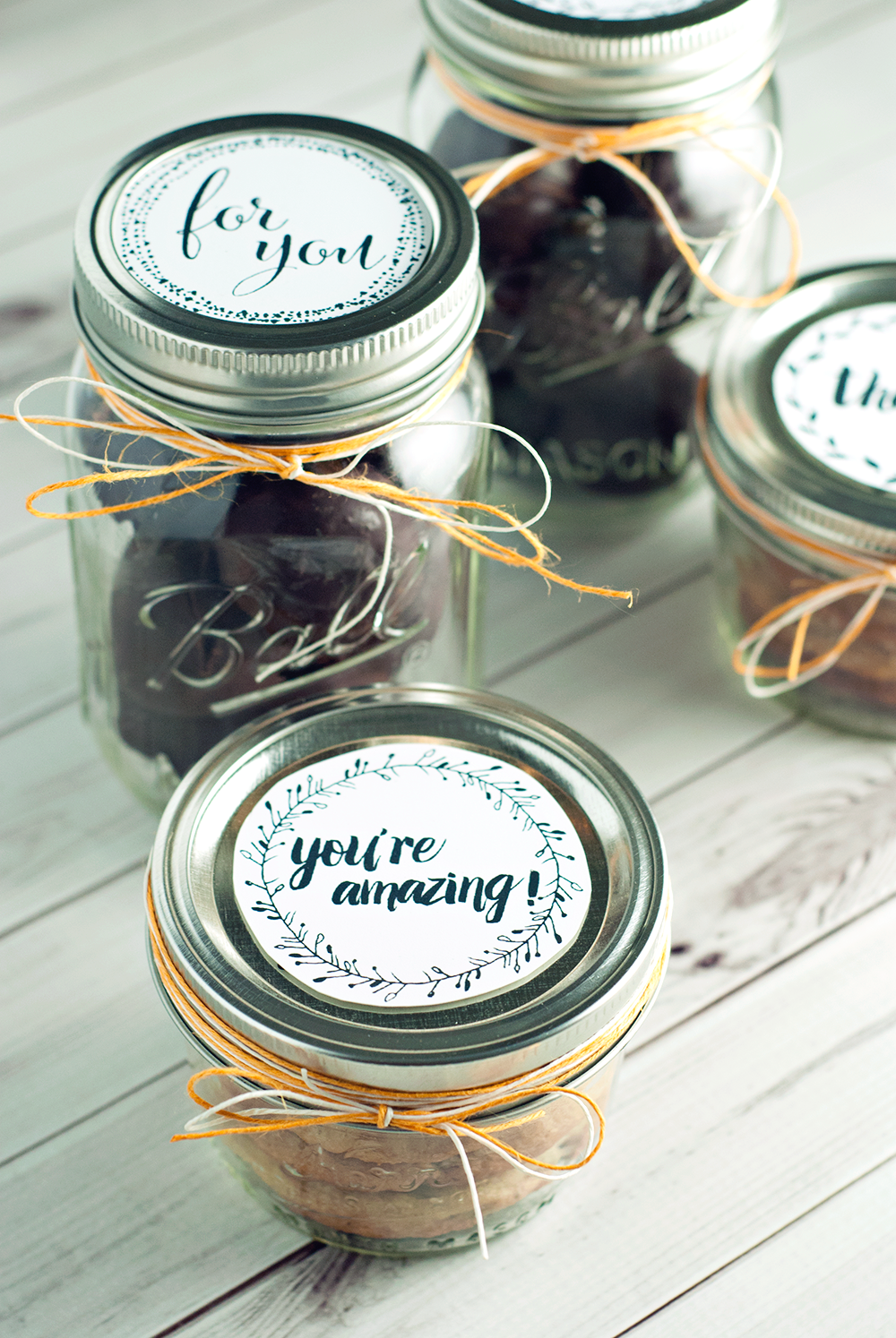 Share the Joy this season by sharing adorable giftable treats in mason jars! Get the recipe for these cookies and truffles, as well as printable rounds for mason jar lids!