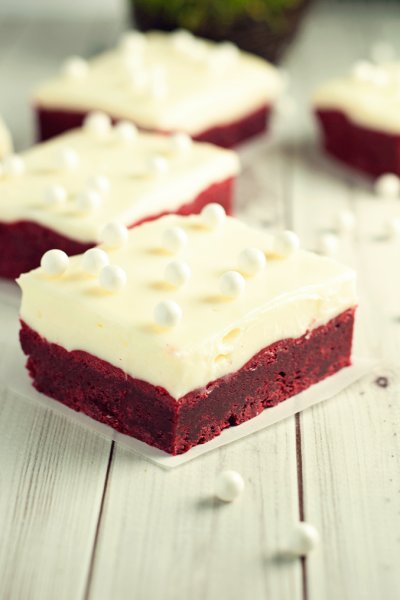 Decadent, moist, and chewy, these red velvet cookie bars with cream cheese frosting will blow your mind!