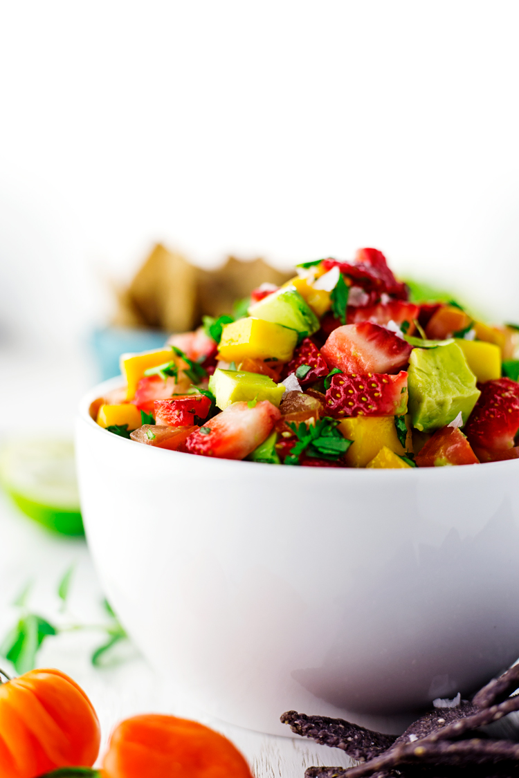 Sweet and refreshing, with a kick of heat from habañero peppers, this Strawberry Mango Salsa will please every palate! | asimplepantry.com