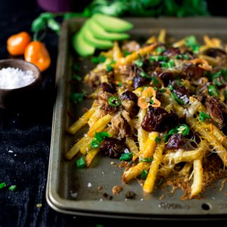 Get your noms on with this super easy Spicy Southwestern Cheese Fries! Ready in just 30 minutes and perfect for any appetite! | asimplepantry.com