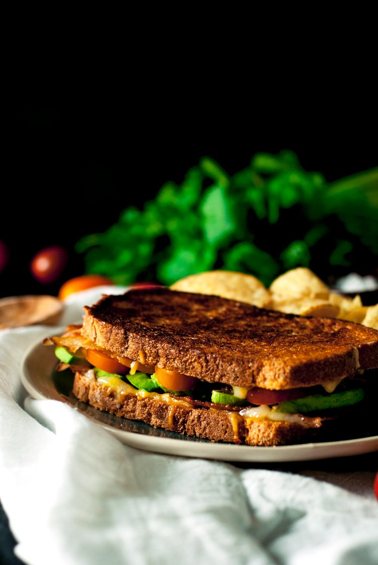 Get your bacon noms on with this super simple and super delicious Avocado Bacon Grilled Cheese sandwich! Ready to eat in under 15! | asimplepantry.com