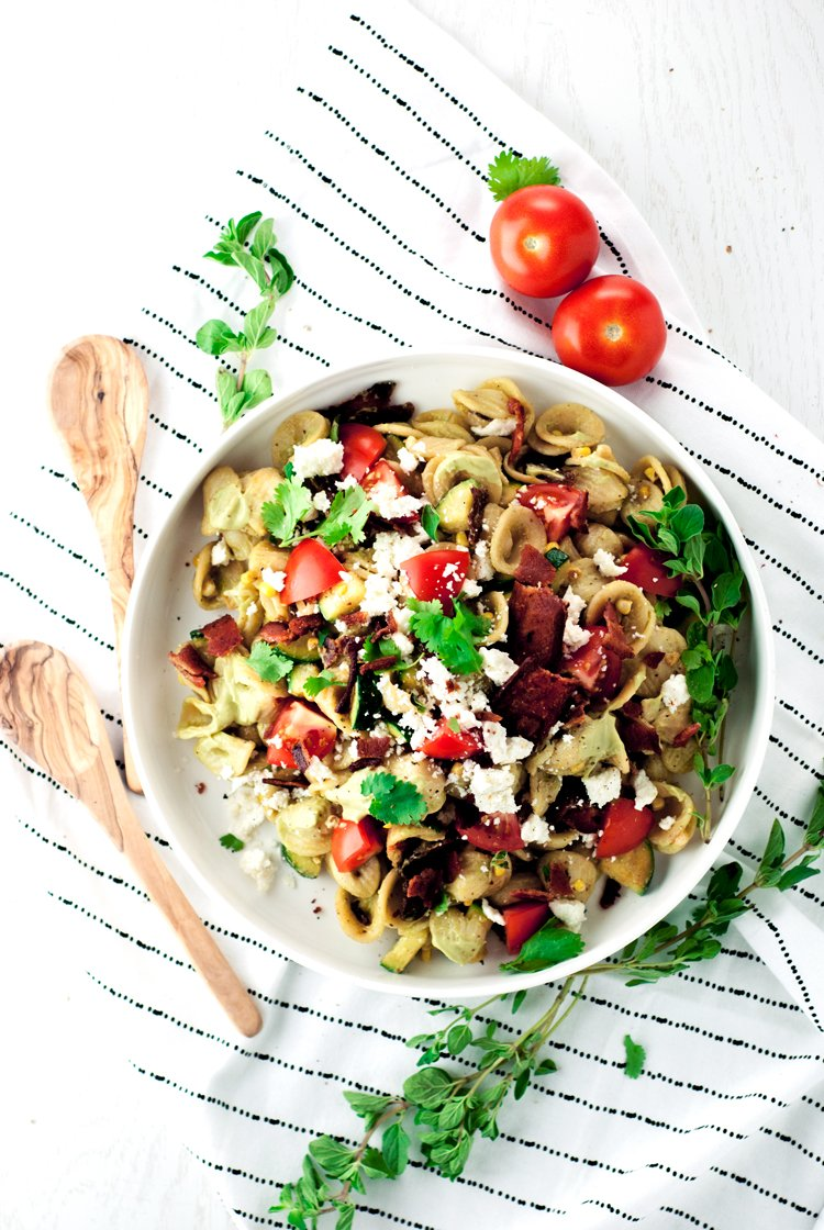 Throw out that boring old pasta salad and say hello to delicious with this Bacon Pasta Salad featuring and amazing Avocado Crema Sauce! | asimplepantry.com