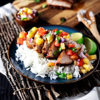 Dinner just got exotic with this amazing Teriyaki Pork with Pineapple Salsa! Dinner is on the table in just 30 minutes with this delish dish! | asimplepantry.com