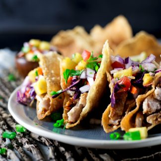 Put that leftover pork to good use in this super easy leftovers meal: Teriyaki Pork Wonton Tacos! Dinner is served in under 20 minutes! | asimplepantry.com