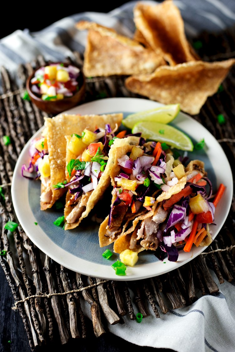 Put that leftover pork to good use in this super easy leftovers meal: Teriyaki Pork Wonton Tacos! Dinner is served in under 20 minutes!   asimplepantry.com