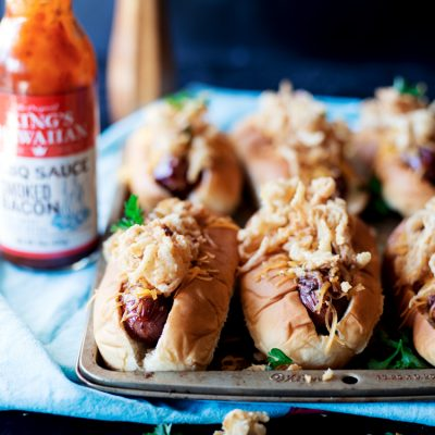 BBQ Bacon Wrapped Hot Dogs with Fried Onion Strings and Cheddar Cheese