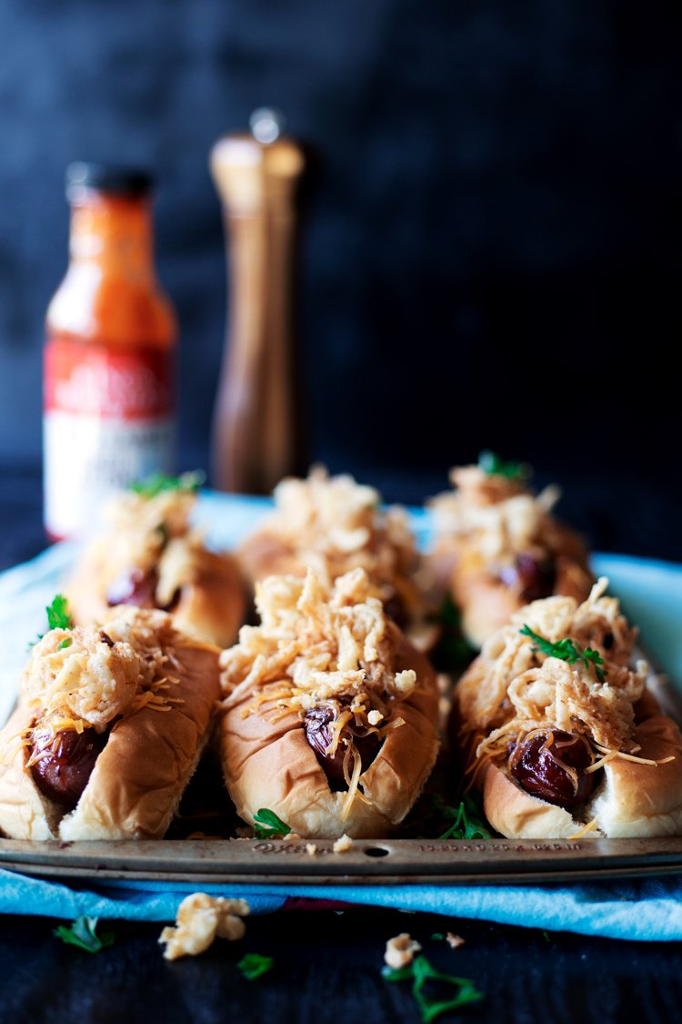 Football season doesn't get much better than this: BBQ Bacon Wrapped Hot Dogs with Fried Onion Strings and Cheddar Cheese. Need I say more? | asimplepantry.com