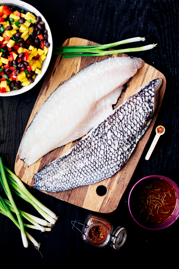 Dinner will never be the same once you've tried this amazingly fresh Spicy Salt and Lime Black Sea Bass with Mango and Black Bean Salad! | asimplepantry.com