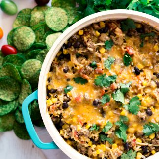 Say hello to the one pot wonder, 30 minute meal of your dinner dreams! This super easy Cheesy Mexican Chili Rice is full of flavor and the perfect comfort food for any night of the week! | asimplepantry.com