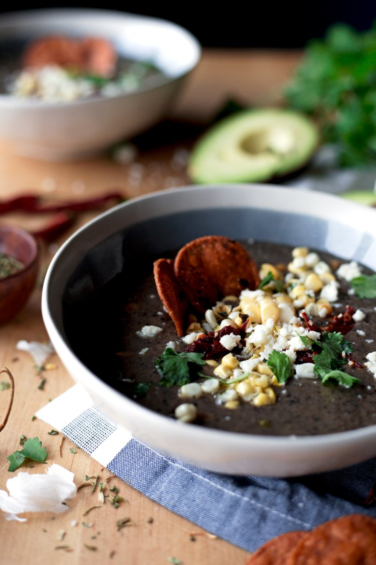 Real food, delicious. Give this Creamy Black Bean and Roasted Poblano Soup a try and warm your soul with its smoky goodness! | asimplepantry.com