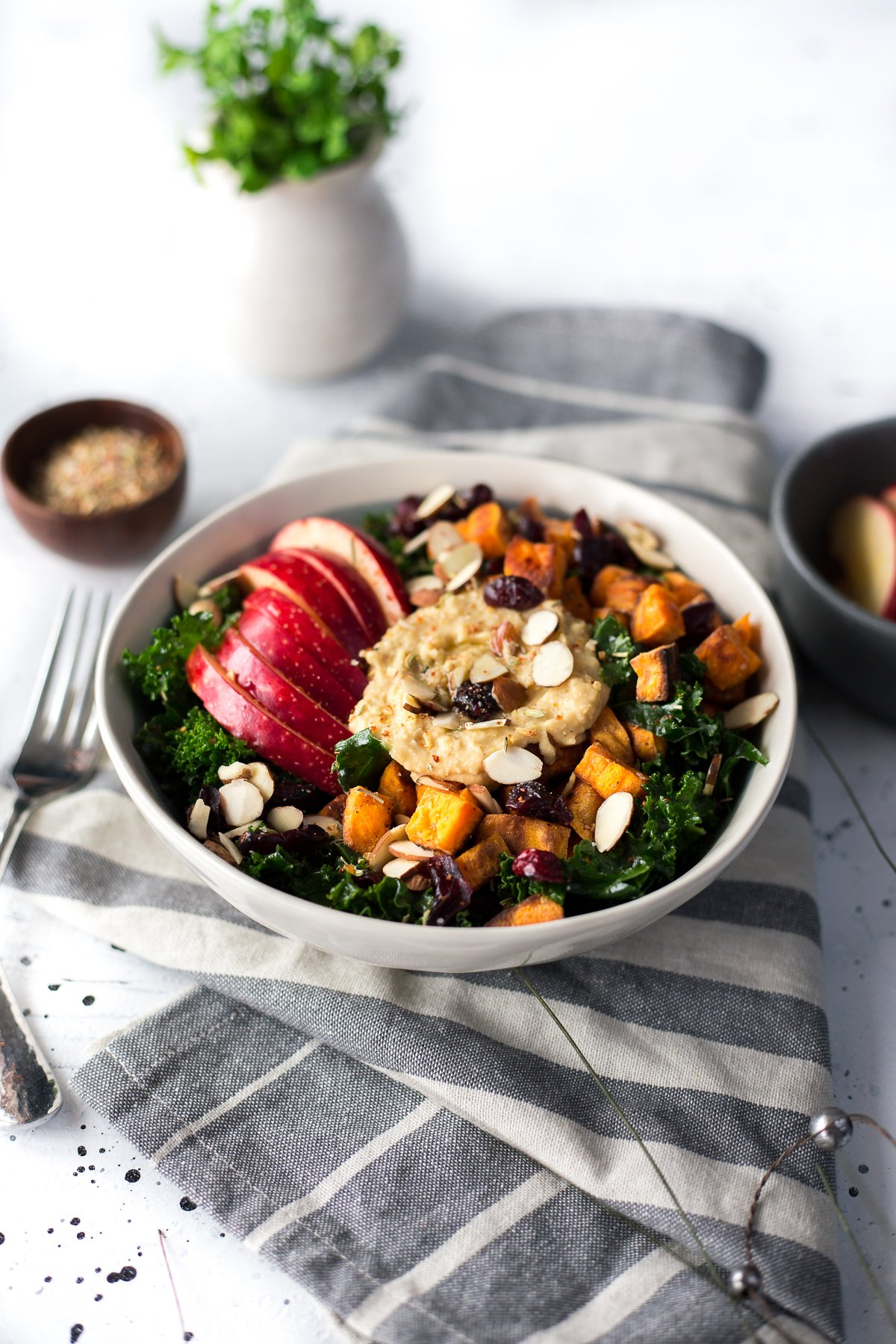 If you're in need of a hummus recipe easy enough to whip together in 30 minutes, then look no further than this amazing Winter Hummus Bowl with roasted sweet potatoes, apples, and kale. | asimplepantry.com