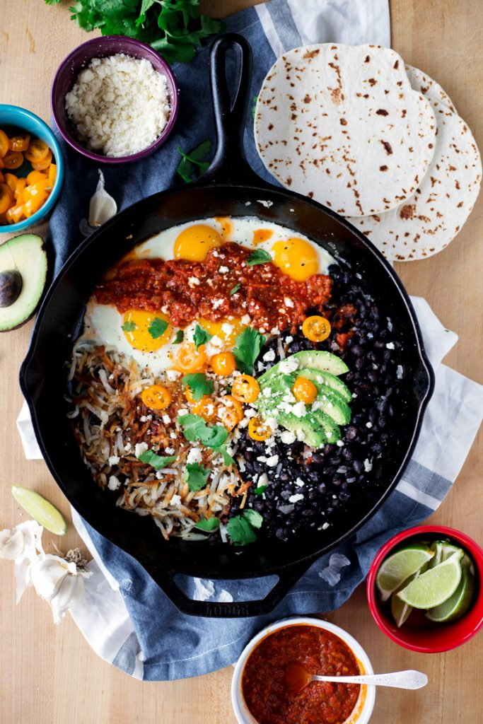 Simple Skillet Huevos Rancheros with Fried Black Beans and Cotija Cheese