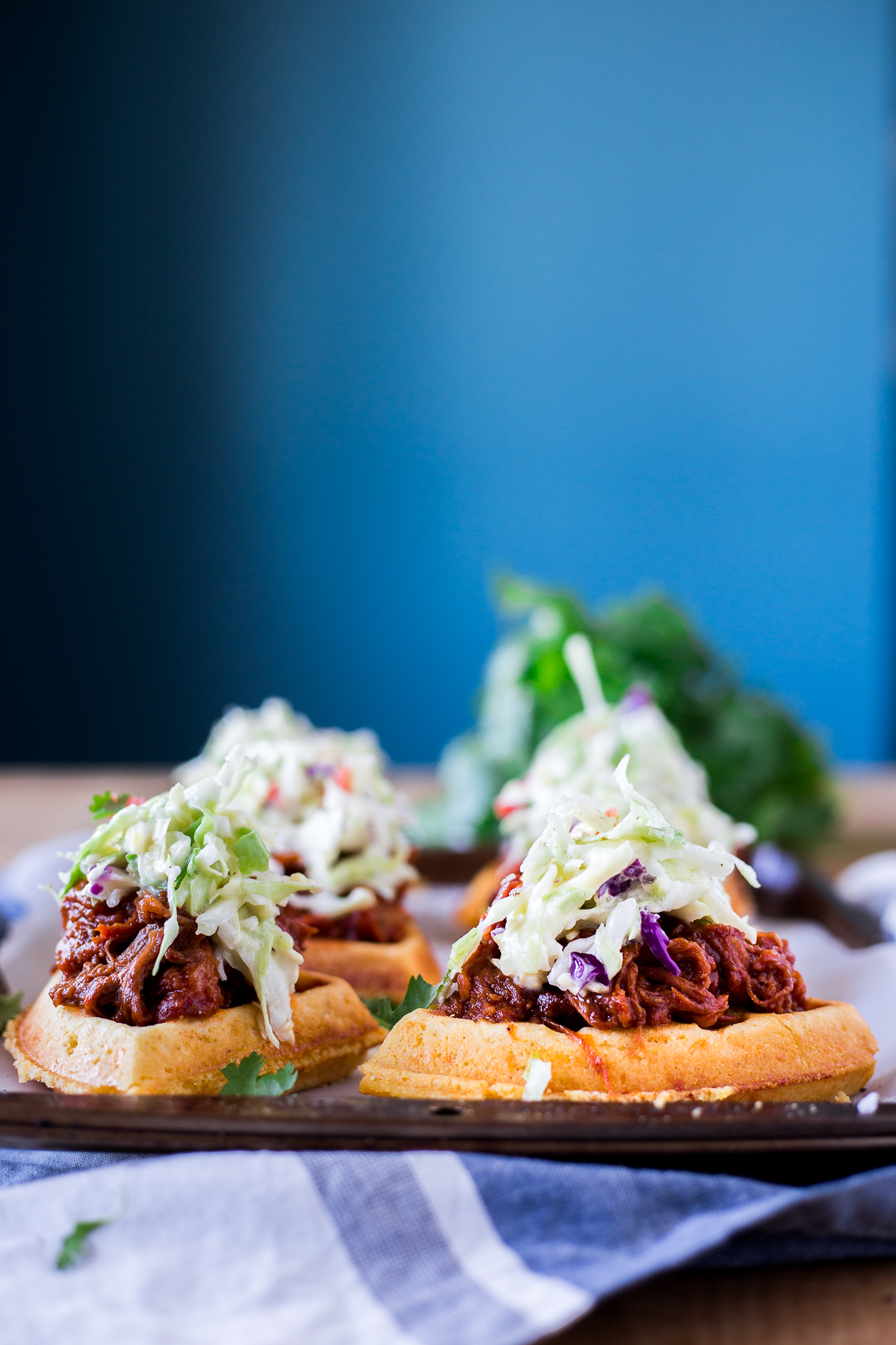 The king of savory waffle recipes, these Sweet & Smoky Pulled Pork Cornbread Waffle Sliders will leave you wanting more! Perfect as an appetizer, or for dinner! | asimplepantry.com
