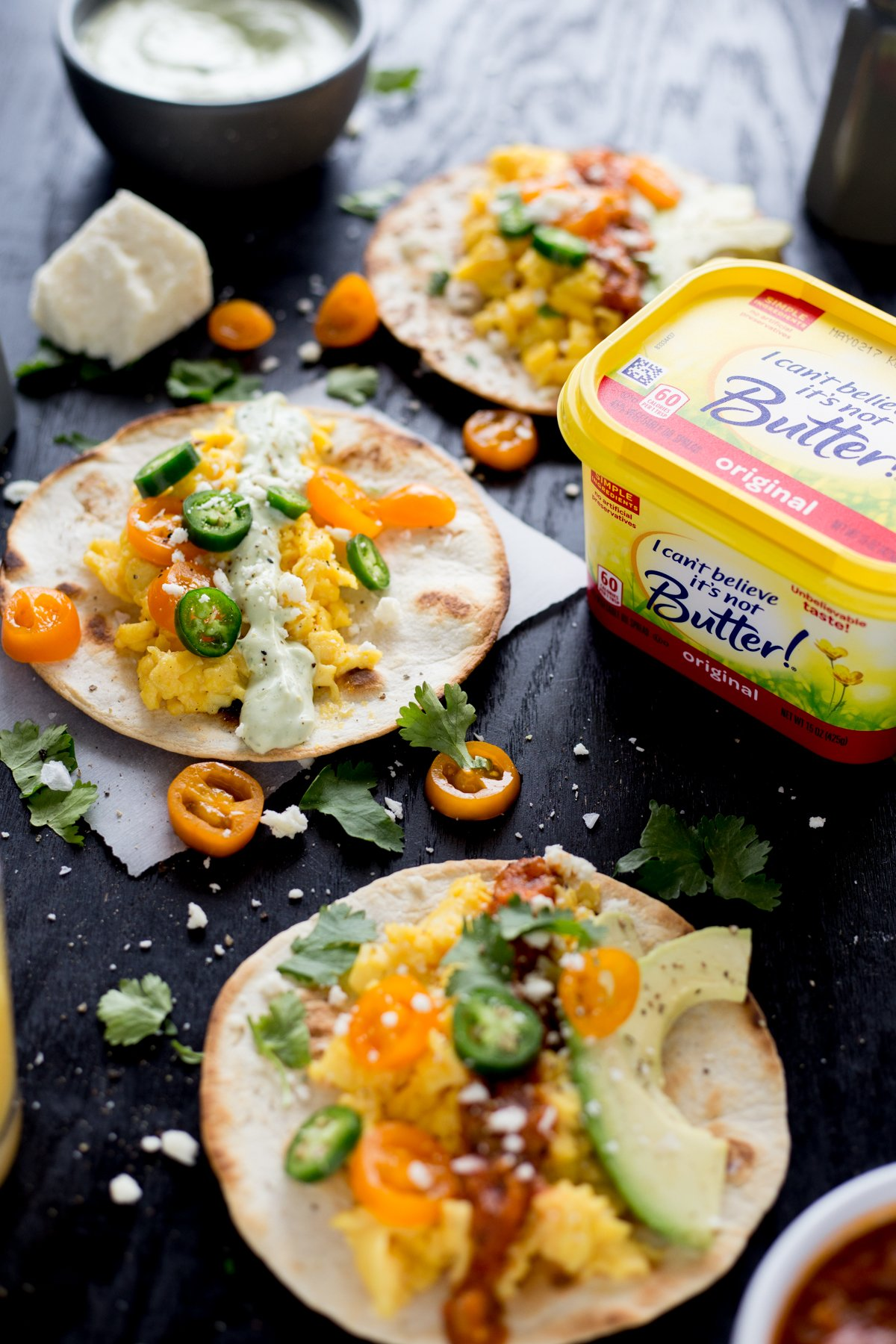 Breakfast recipes, easy and in a hurry, cannot be beat with these amazing Mexican breakfast tacos! Two blender sauces, lots of salty cheese, and fresh produce FTW! | asimplepantry.com