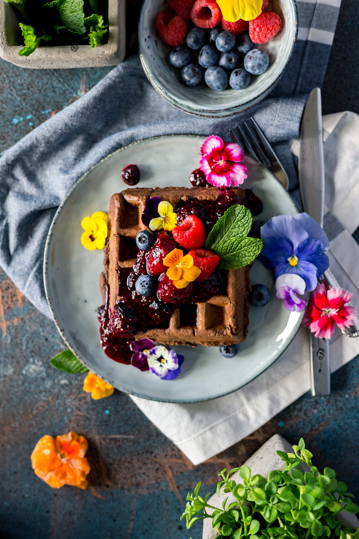 Breakfast or dessert? You decide when you whip up these sweet and savory waffle recipes! Dig into chocolate waffles with triple berry compote today! | asimplepantry.com