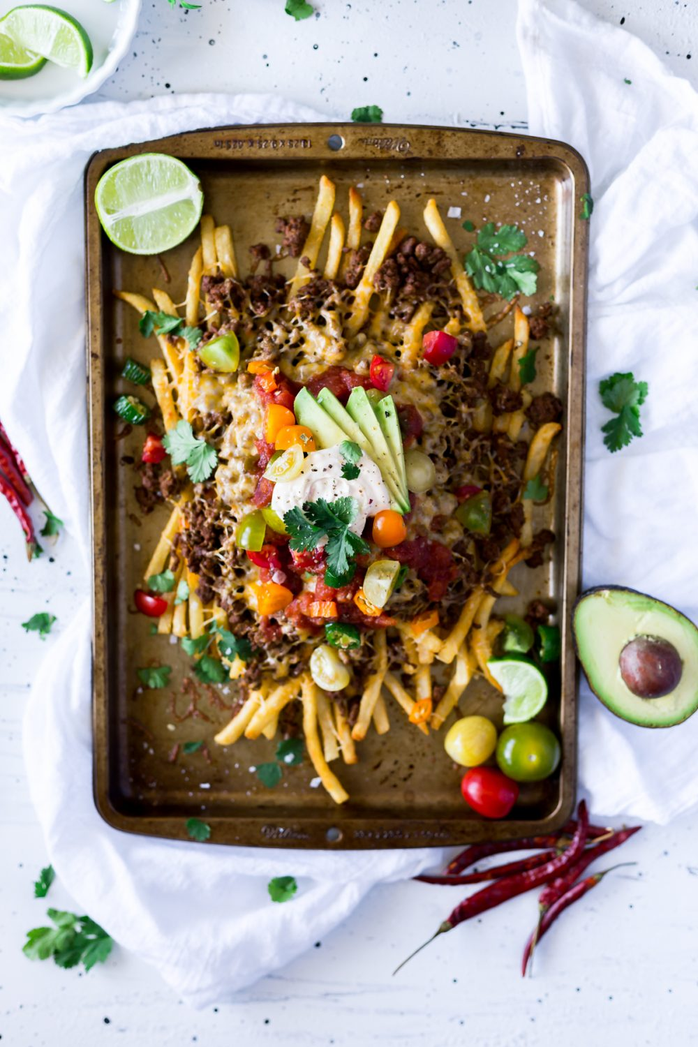 Celebrate Cinco de Mayo, or any occasion, with these Mexican Nacho Fries! Whether as an appetizer or dinner, easy Mexican recipes just cannot be beat! | asimplepantry.com