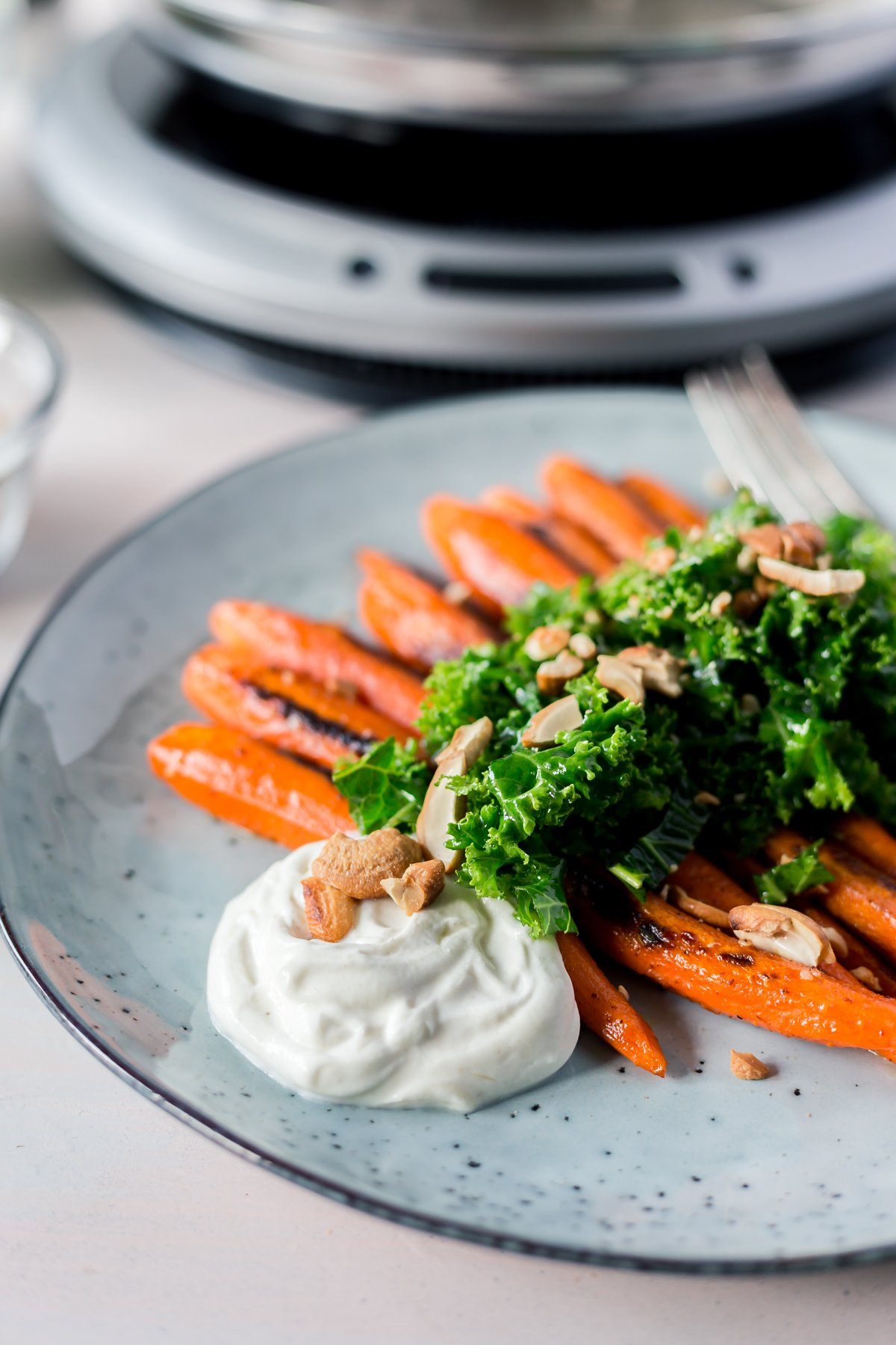 The perfect side dish to any meal, this roasted carrots and kale salad with za'atar seasoning will quickly become a family favorite at dinner! An easy recipes win! | asimplepantry.com