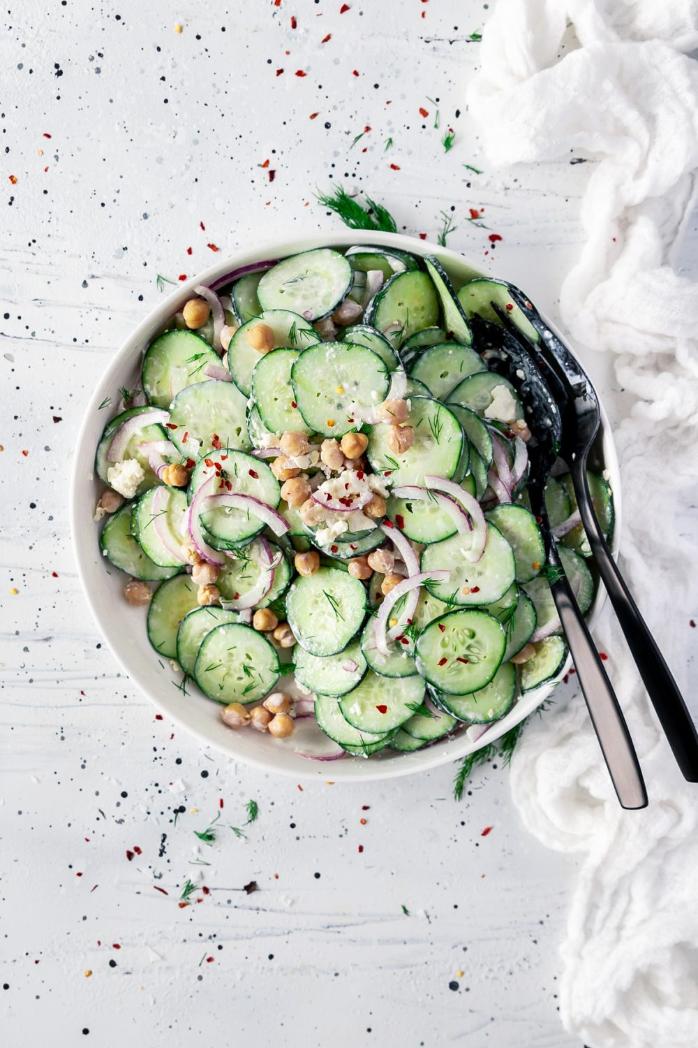 creamy cucumber salad with chickpeas, red onion, feta, and dill.