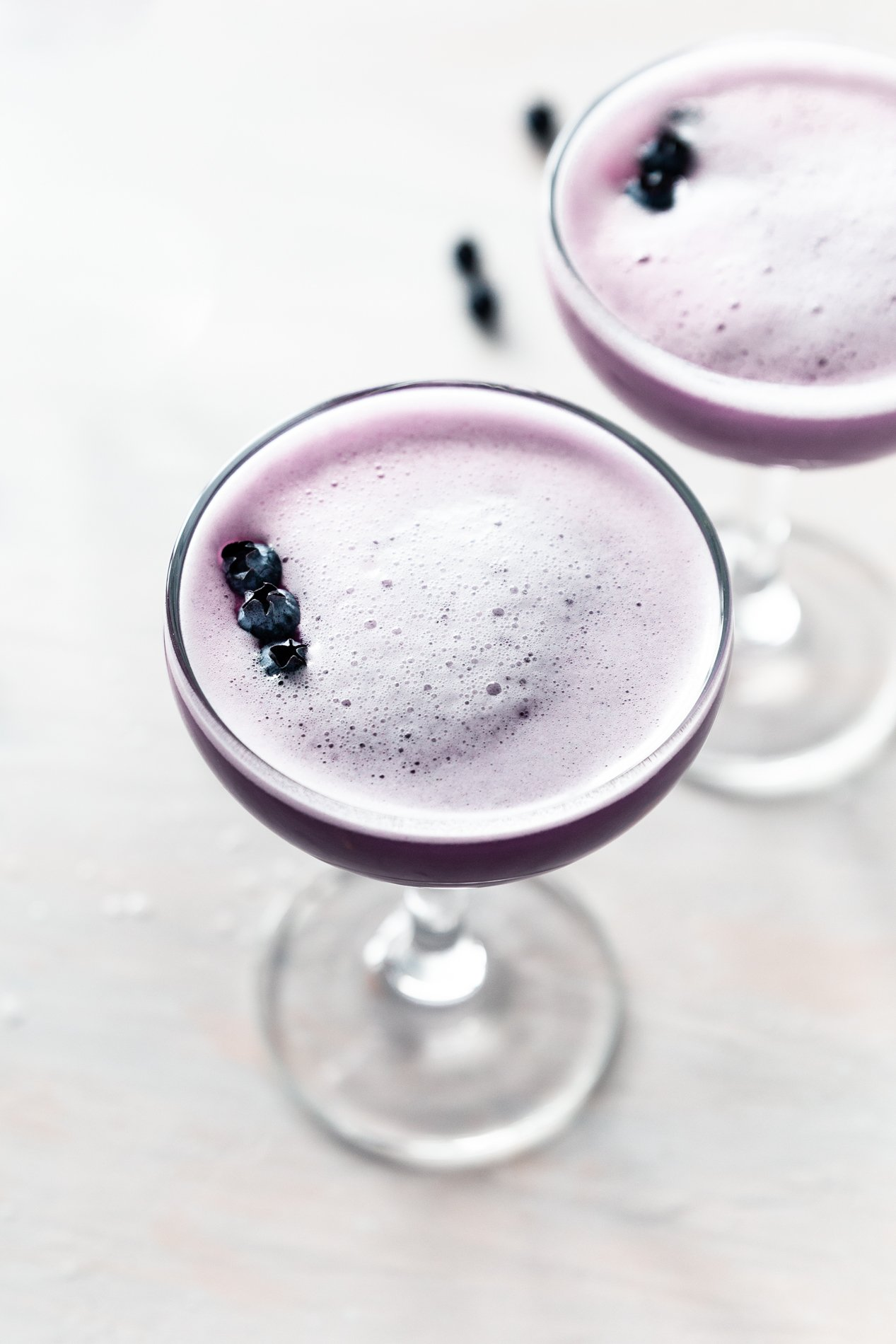 side view of blueberry clover club cocktails by minneapolis food blogger asimplepantry