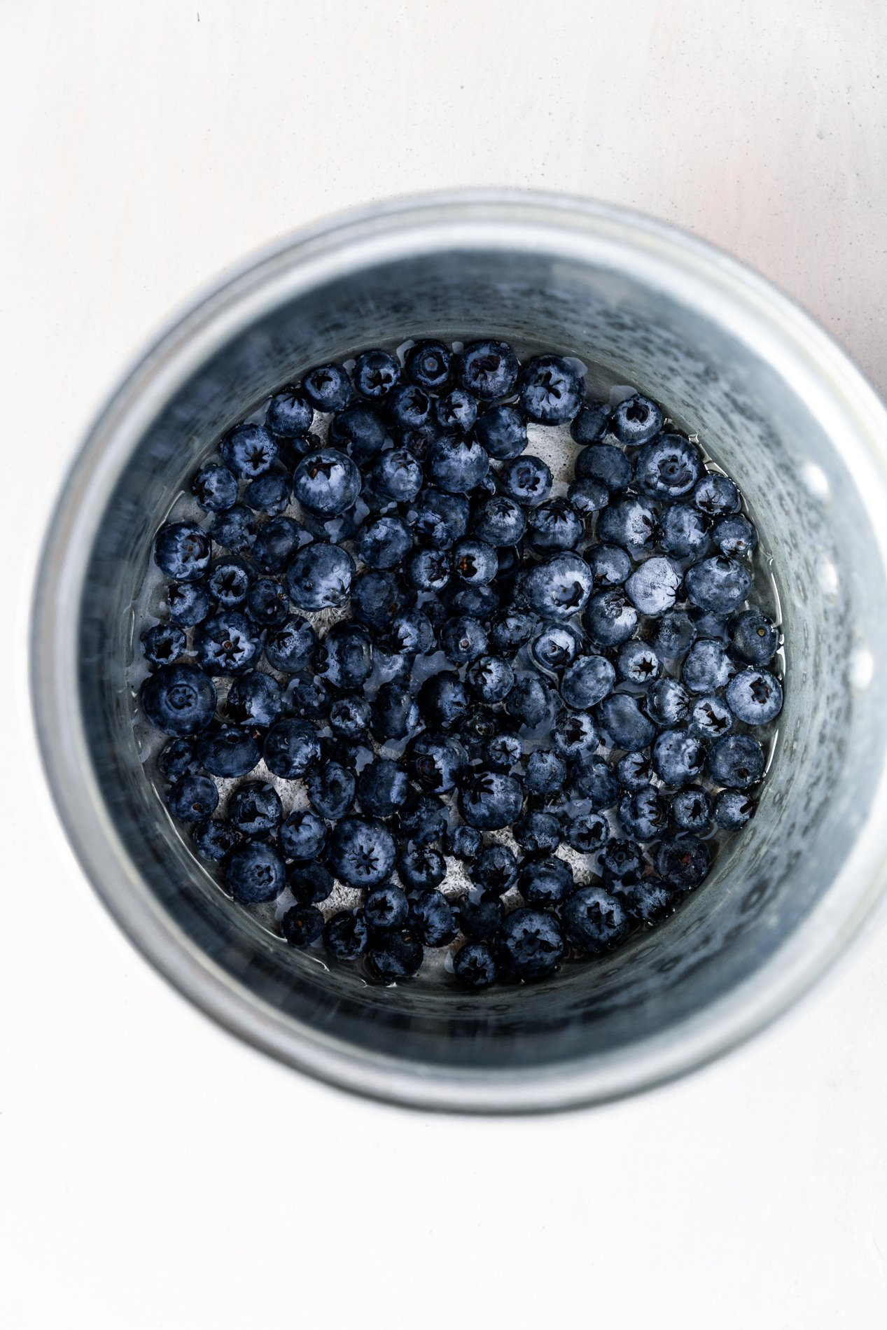 overhead view of a pot of blueberries