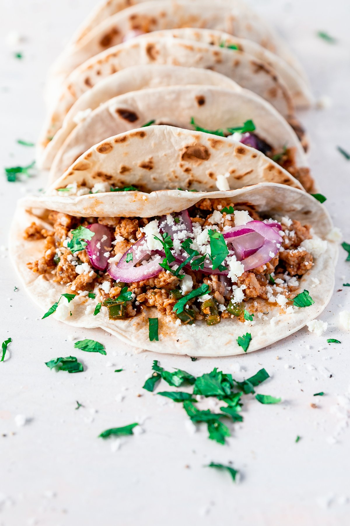 angled view of weeknight pork carnitas tacos by minnesota food blogger a simple pantry