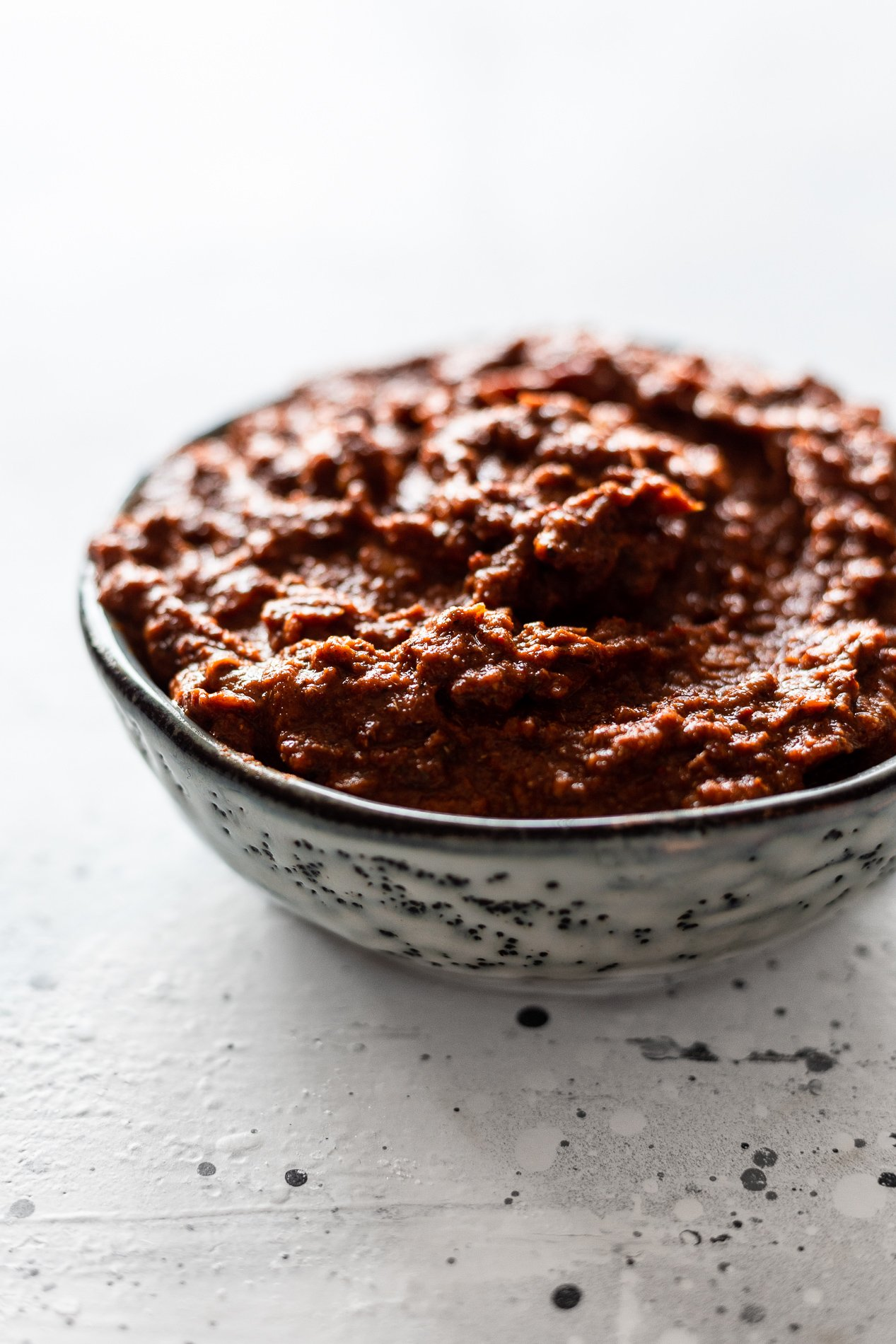 side angle of a small bowl of chipotle marinade after being blended for chipotle sheet pan chicken fajitas