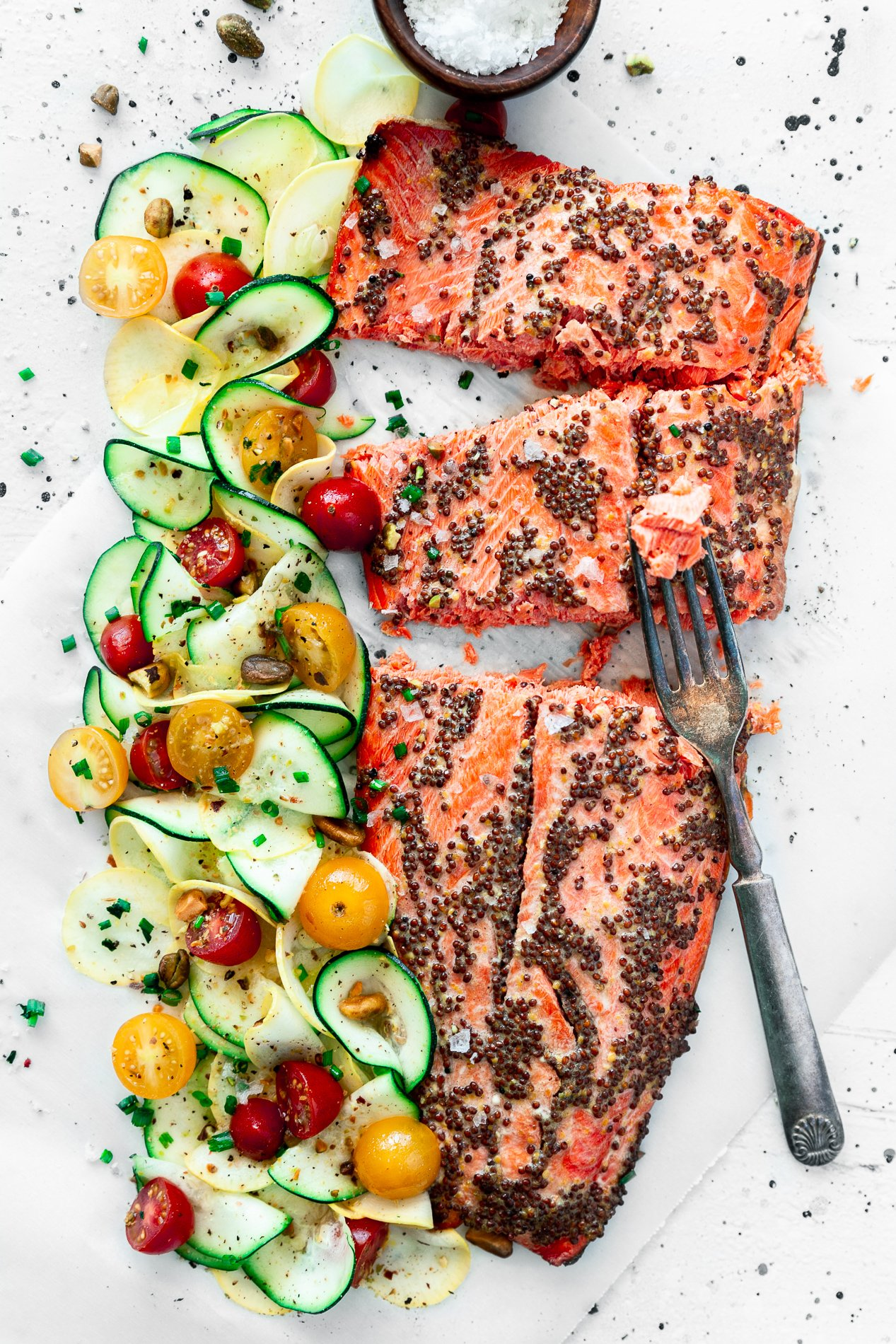 overhead view of mustard salmon with citrus squash salad and a fork