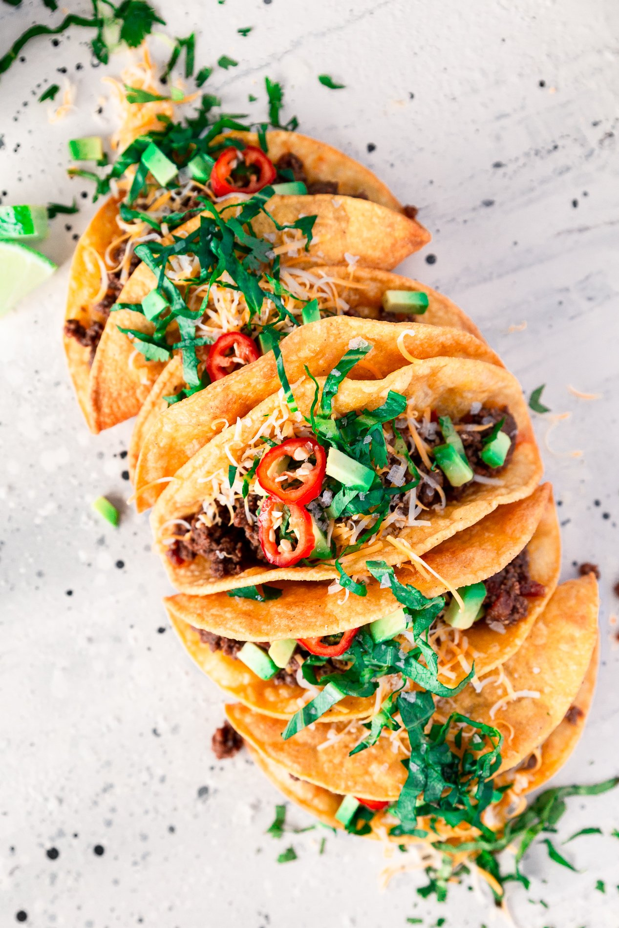 angled overhead view of crispy beef tacos from minnesota food blogger asimplepantry