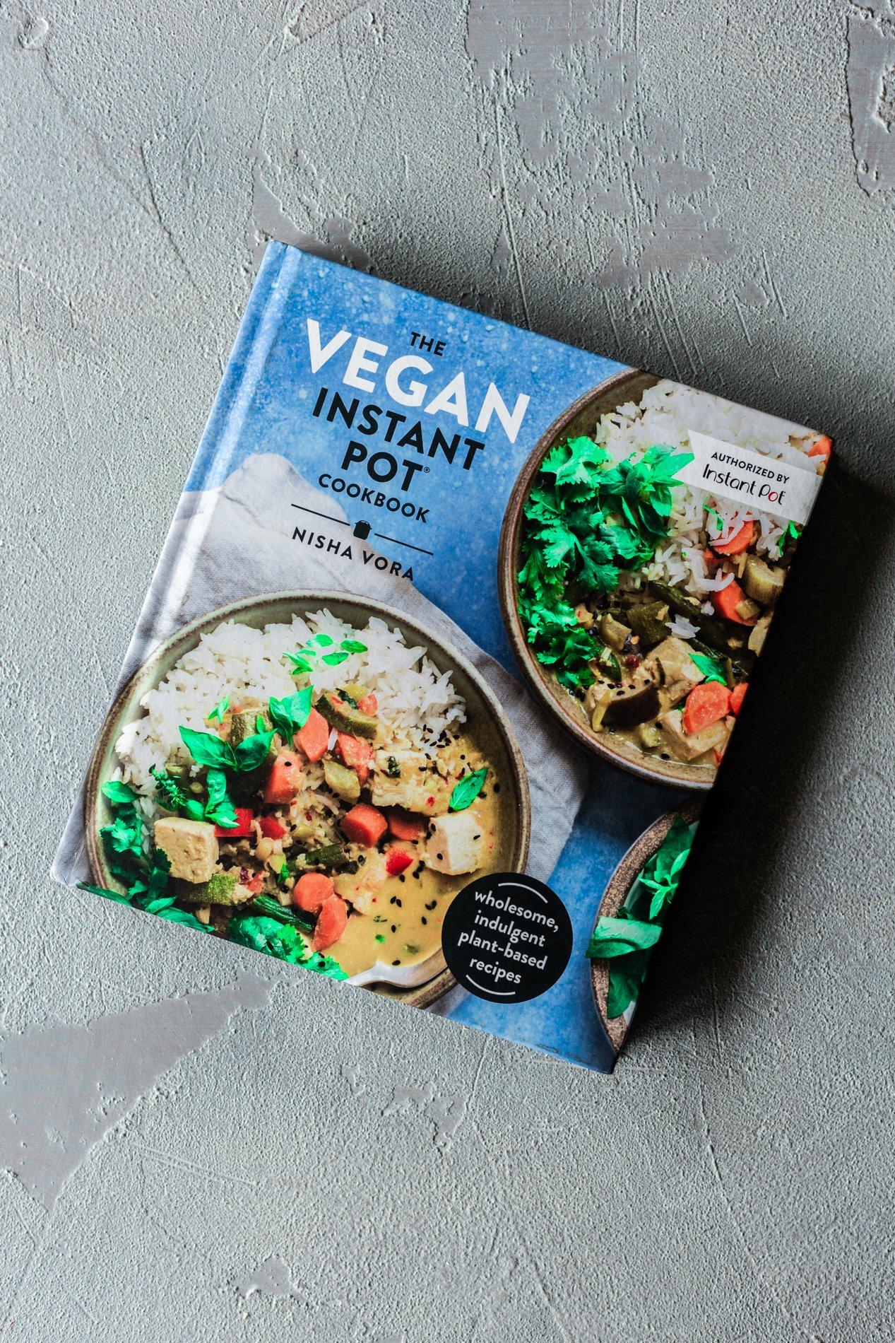 overhead view of the vegan instant pot cookbook by nisha vora