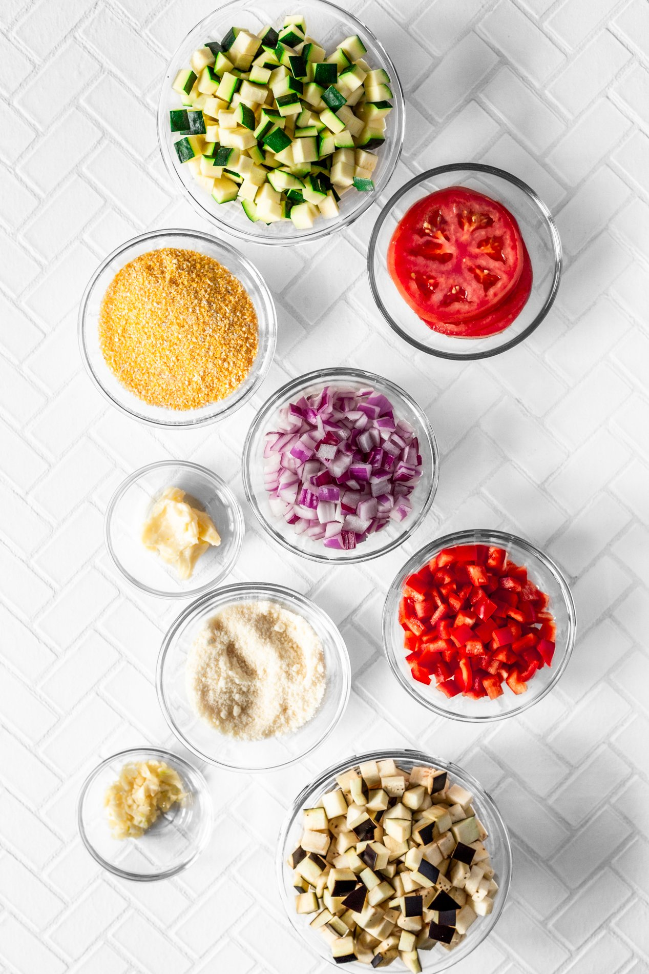 overhead view of individual ingredients for easy ratatouille recipe with creamy polenta