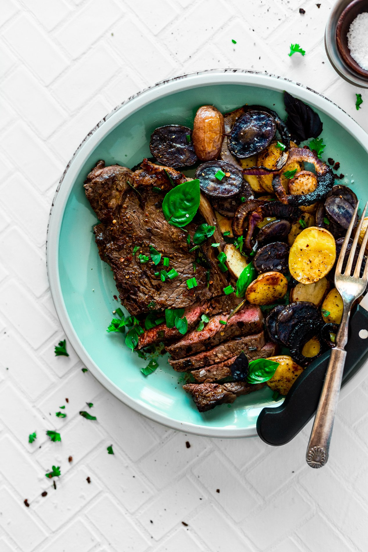 overhead view of chipotle herb pan seared steak recipe with roasted potatoes