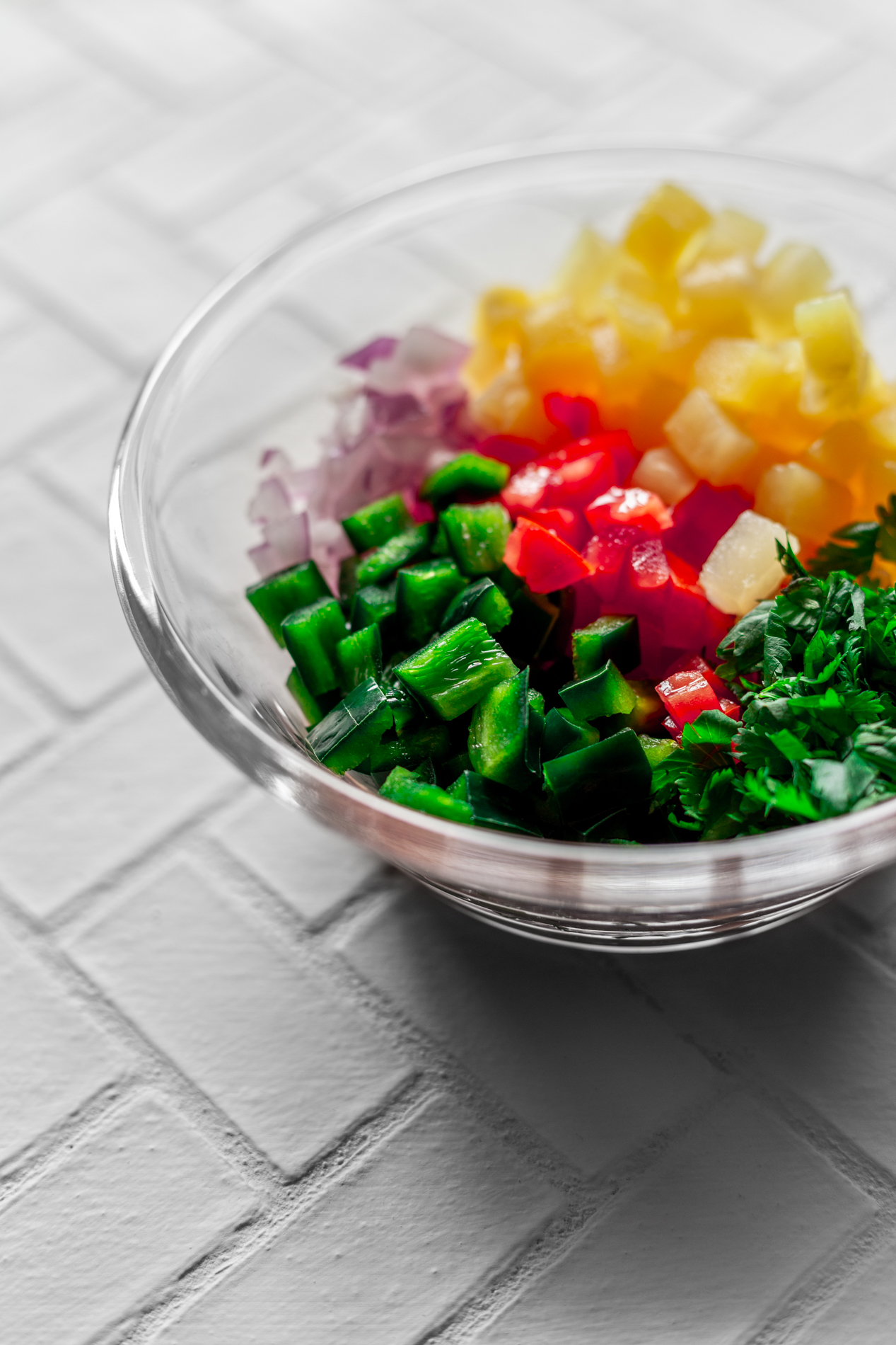 angled view of a bowl of fresh diced produce