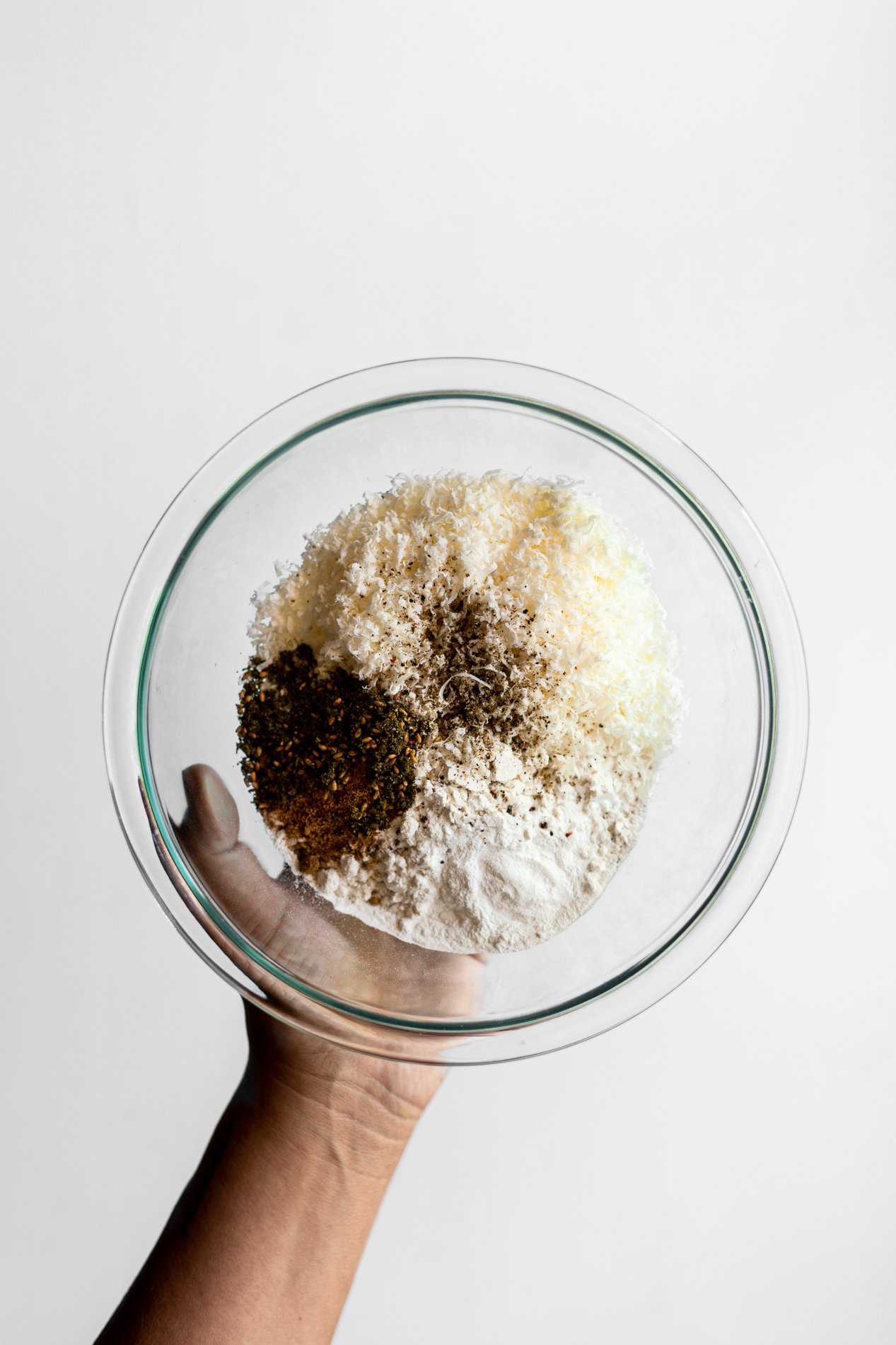 overhead view of a bowl of dry ingredients for za'atar spiced zucchini fritters