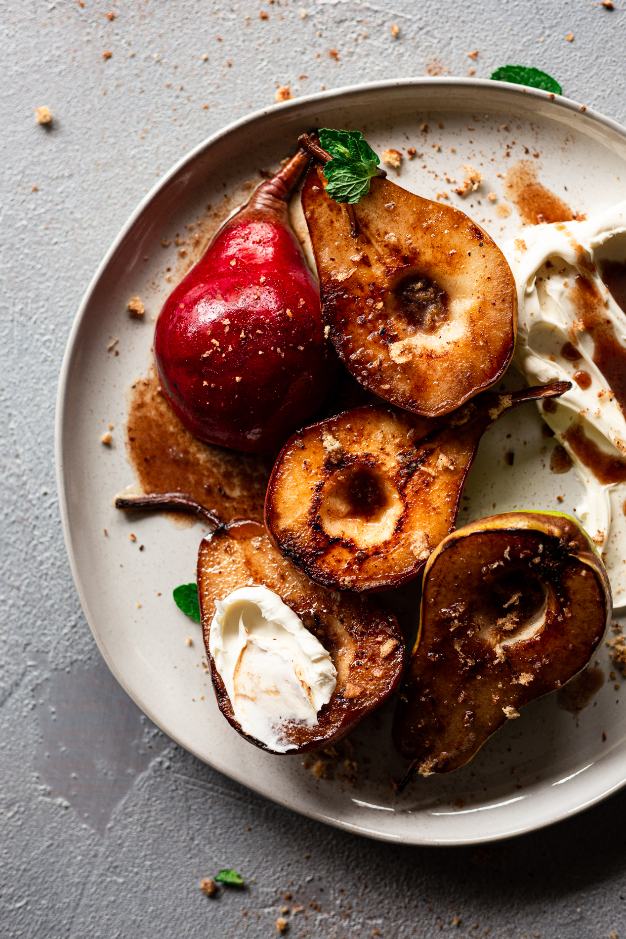 overhead view of roasted pears with honey-spiced brown butter, mascarpone, and cinnamon toast sprinkles