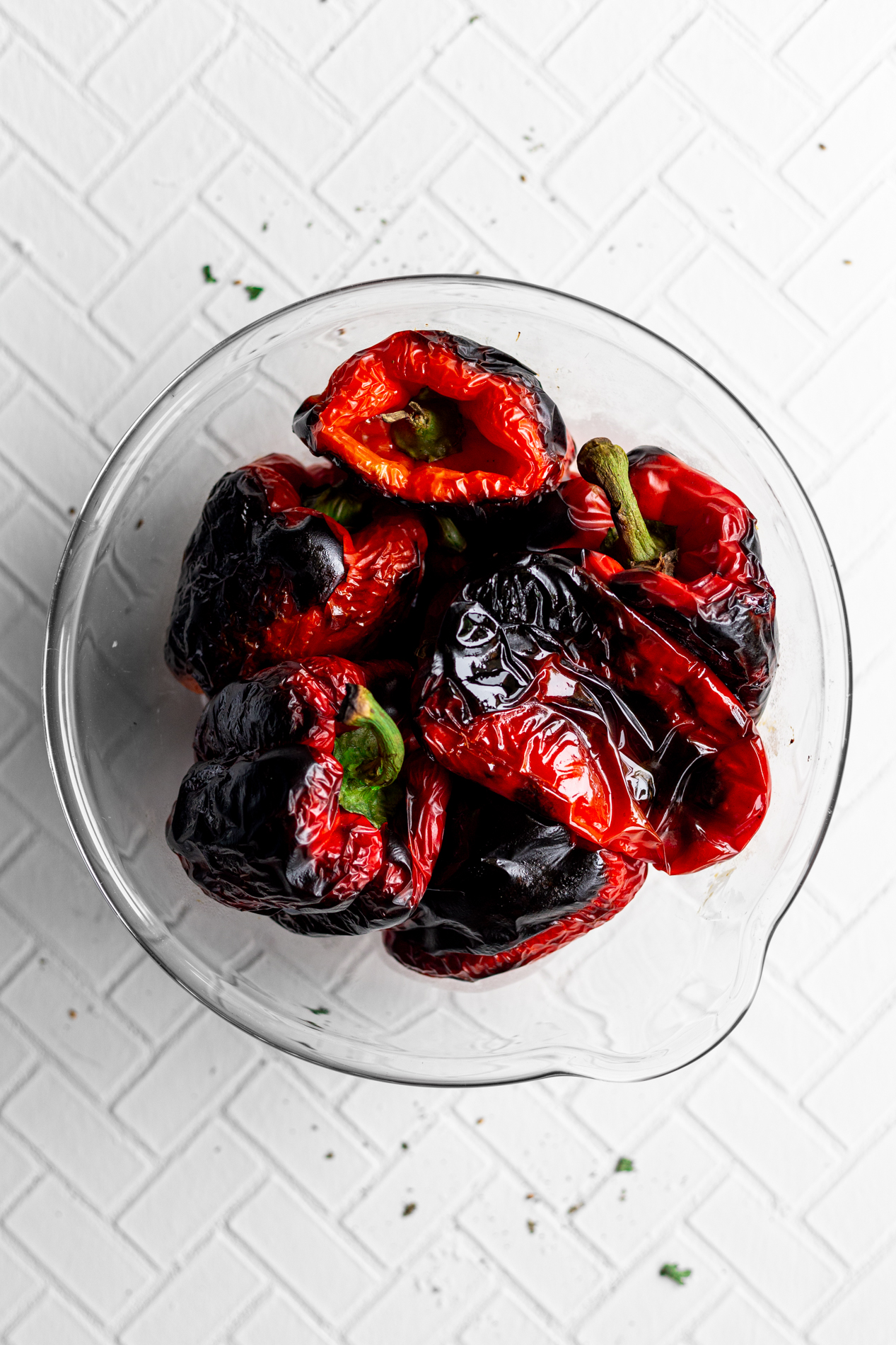 red bell peppers in a bowl after being roasted