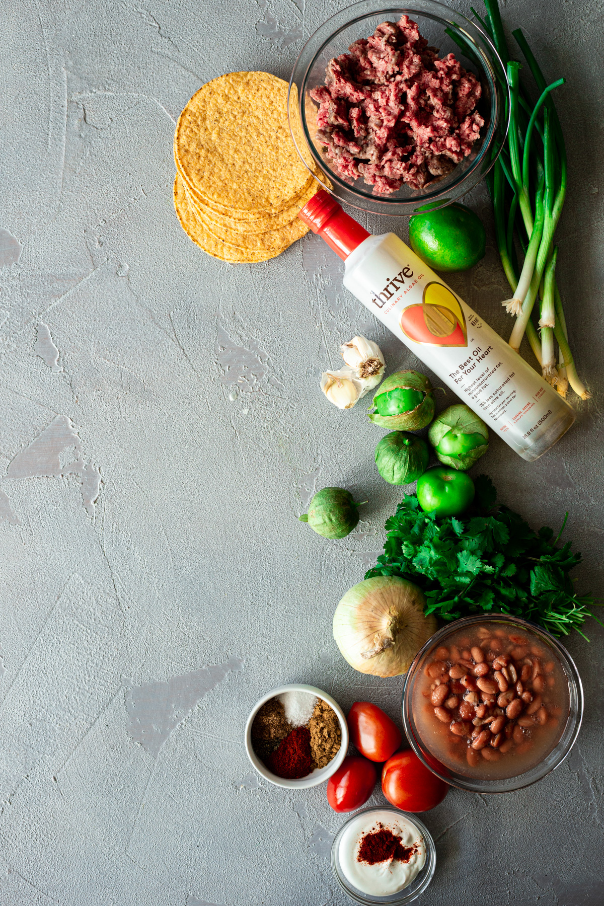 ingredients for bean and beef tostadas with tomatillo salsa and chipotle crema