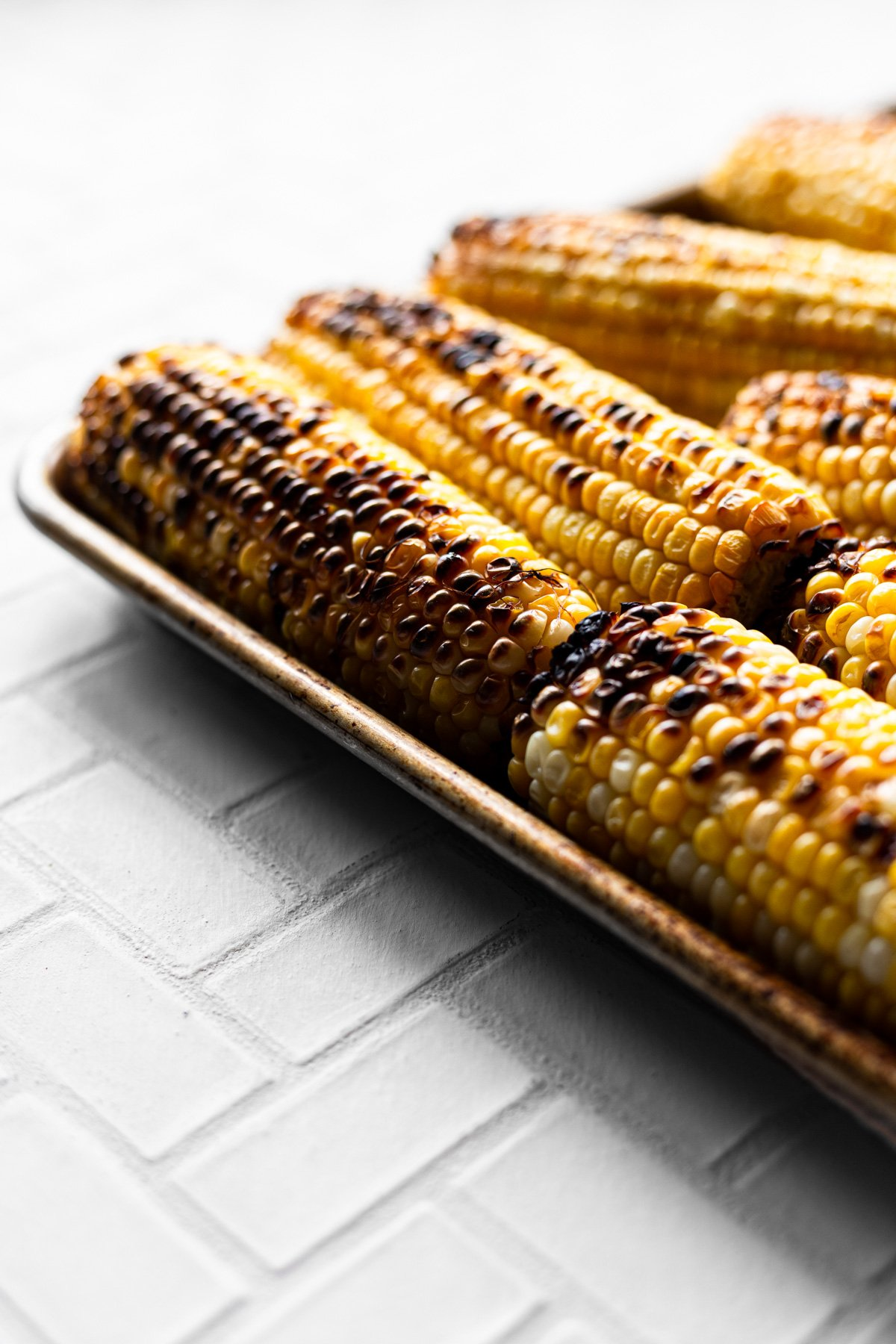 roasted corn on a sheet pan for arugula salad recipe