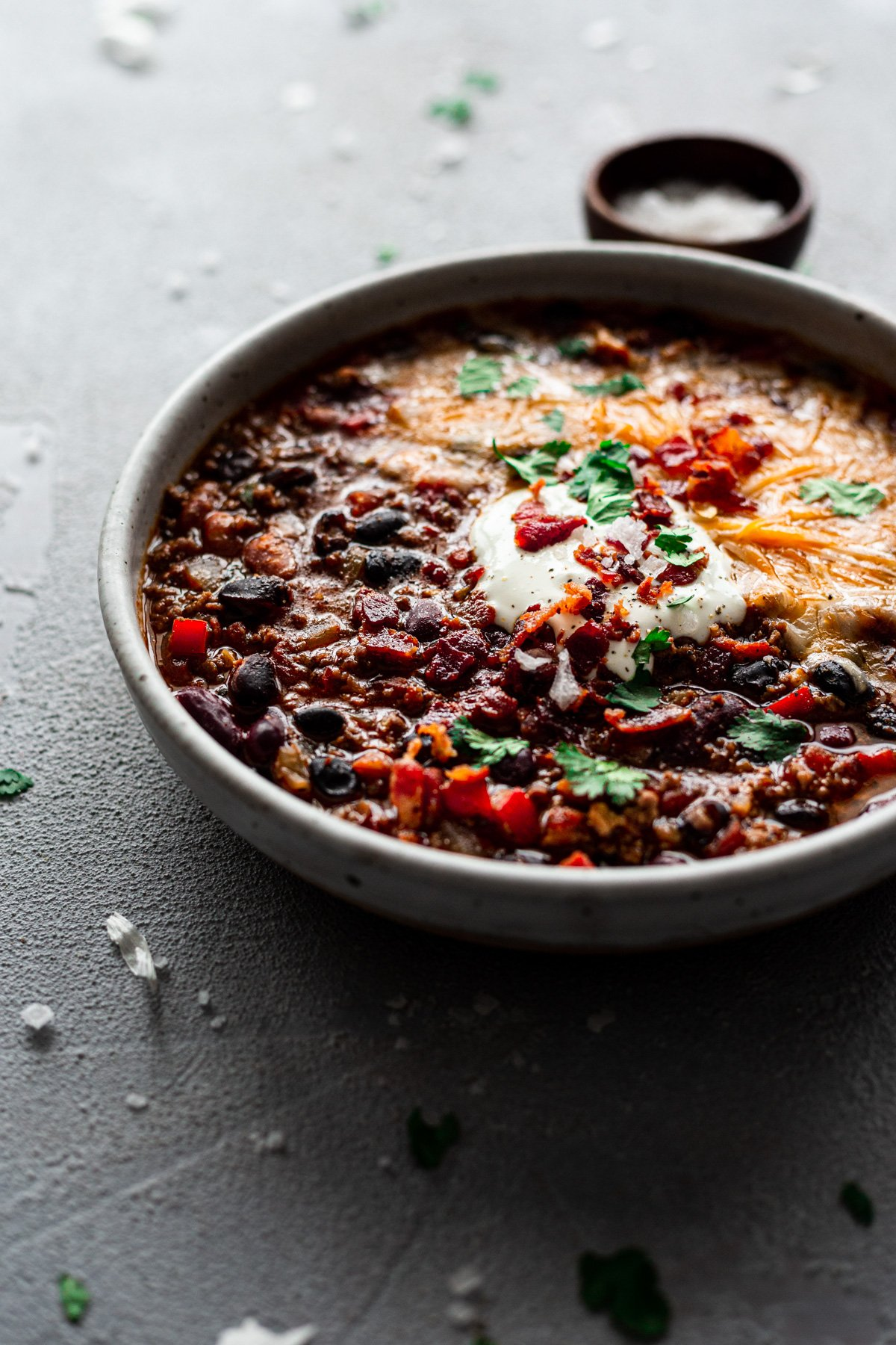 a bowl of the best chili recipe ever with cheese and sour cream