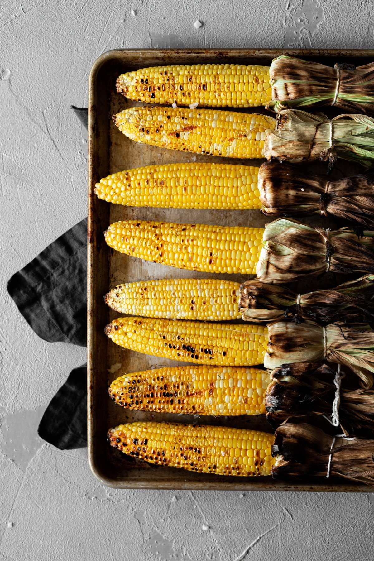 grilled and charred corn on the cob before dressing into mexican street corn