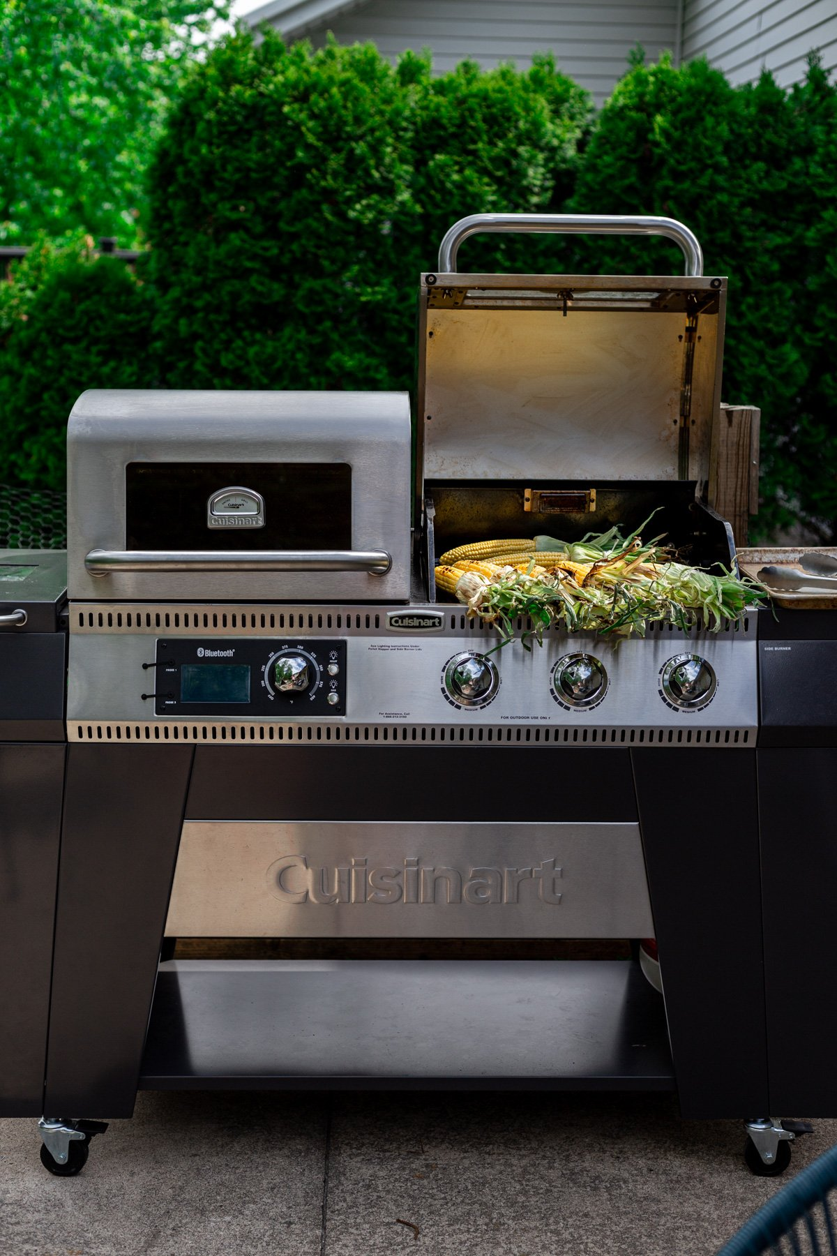 cuisinart twin oaks pellet & gas grill with fresh corn being grilled