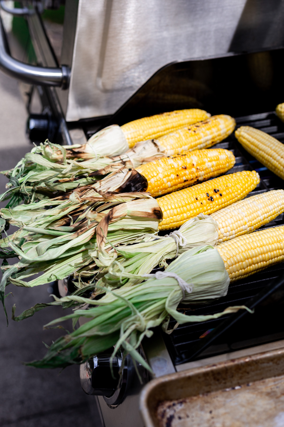 fresh corn being grilled on the gas side of the twin oaks grill
