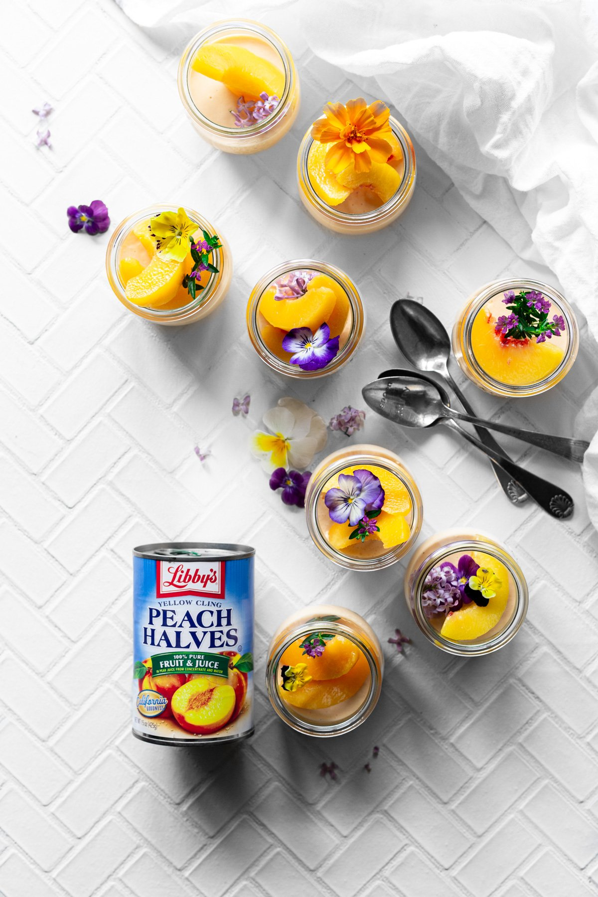 overhead view of jars of peach jello salad with a can of Libby's Peach Halves