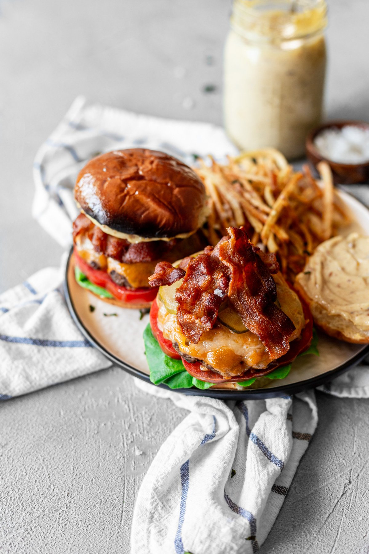 Bacon smash burgers with cheese, bacon, bacon aioli, lettuce and tomato, with thin-cut fries