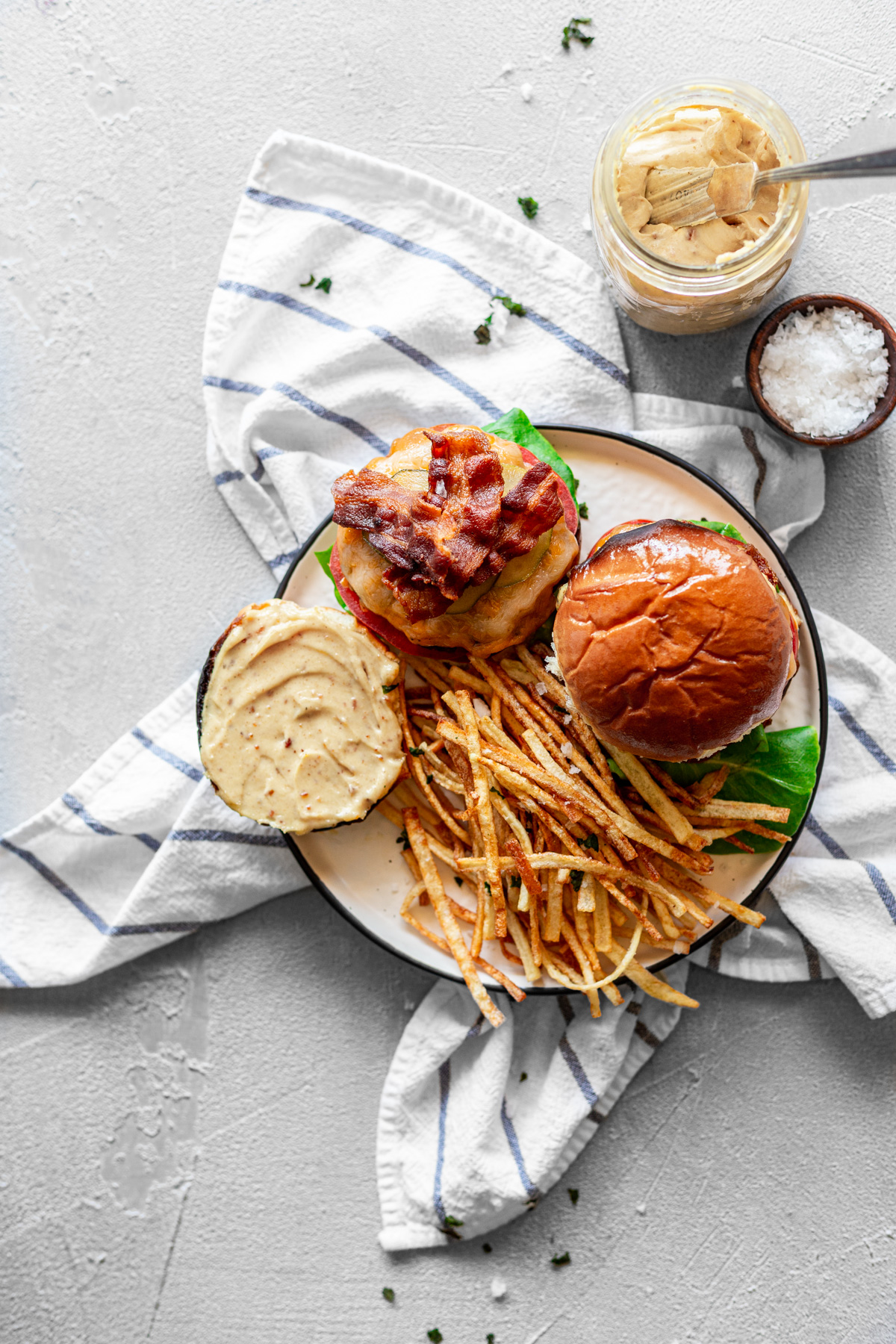 Two bacon burgers with bacon, cheese, bacon aioli, lettuce & tomato with thin-cut fries