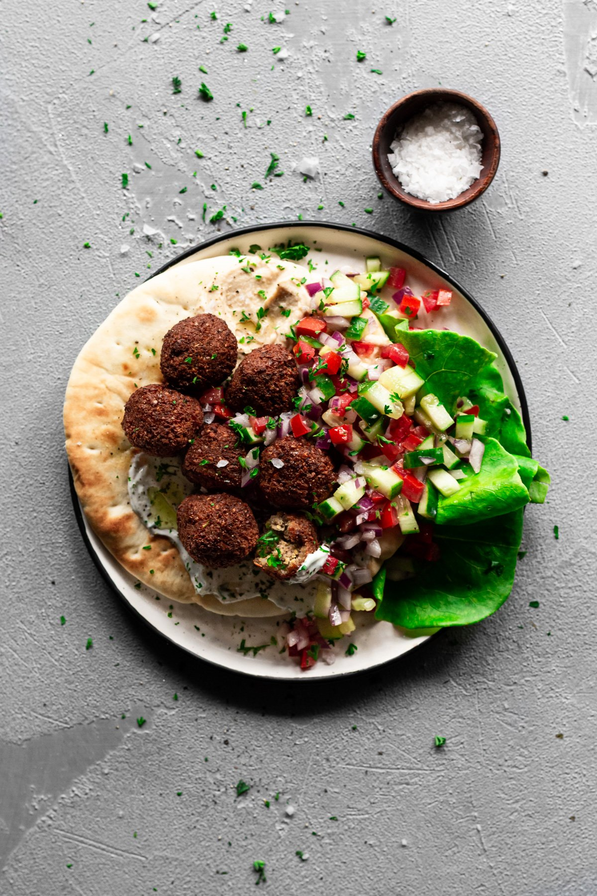 falafel on a pita with hummus, tzatziki, and israeli salad