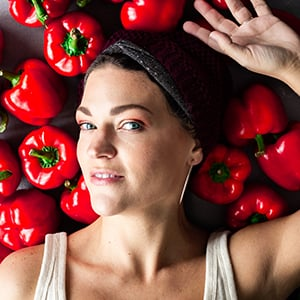 author karly gomez of a simple pantry with a background of red bell peppers