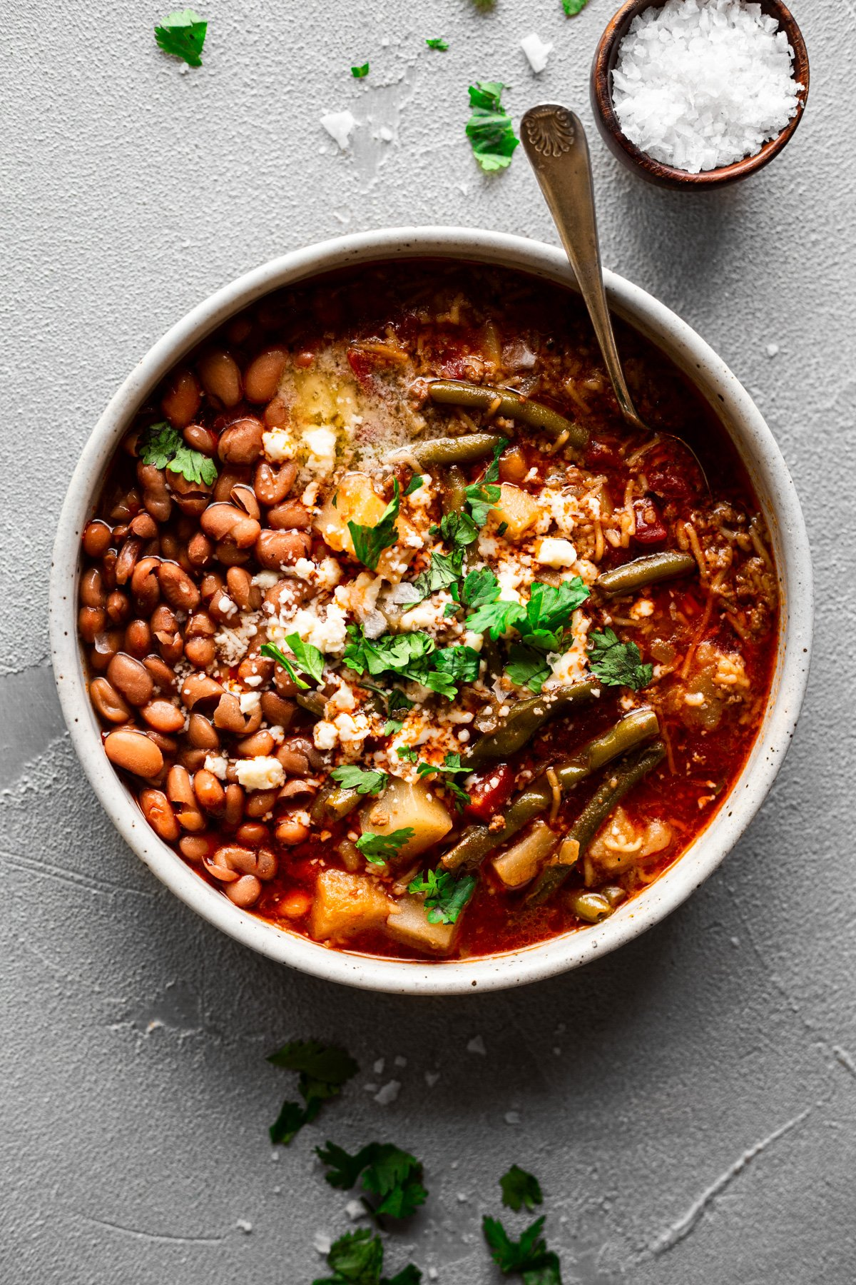 fideo loco bowl of picadillo, pinto beans, and broth